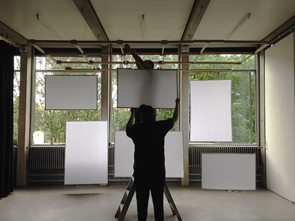 Hanging frames during set up for the Gerrit Rietveld Acdemie's Graduation Show 2016